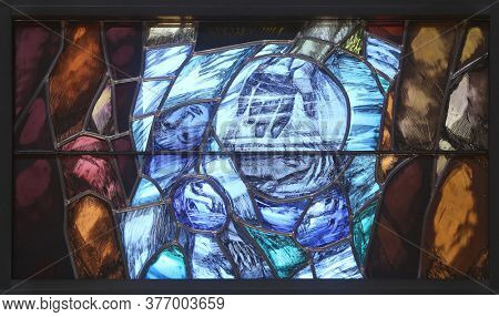 PIFLAS, GERMANY - JUNE 07, 2015: God leads his own to completion in all his glory, detail of stained glass window by Sieger Koder in church of Saint John in Piflas, Germany