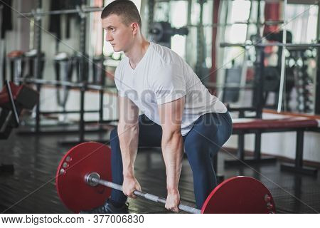 Athlete Doing Deadlift N Style Sumo In Gym