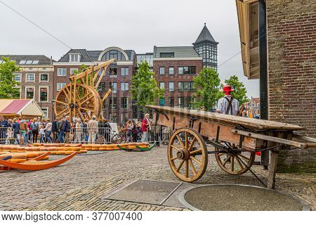 Alkmaar, North Holland / Netherlands. June 11th. 2016. Wooden Cart, Cheeses At The Cheese Market In