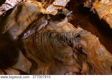 Inside A Karst Cave With Various Ancient Stalactites And Stalagmites From Salts And Minerals, As A B
