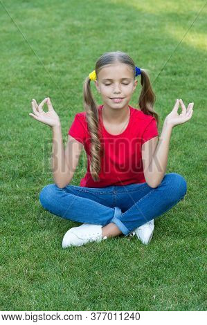 Meditation Practice. Little Child Do Meditation On Green Grass. Small Girl Sit In Mudra Position Dur
