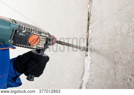 A Jackhammer Handles A Gap In A Concrete Wall