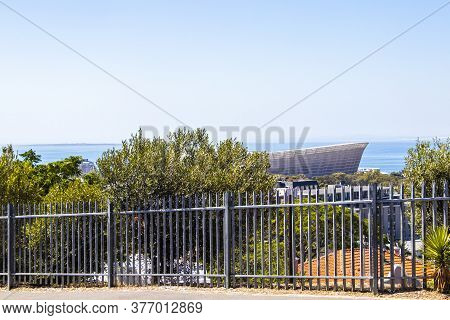 Famous Cape Town Stadium Behind Fence In Cape Town, South Africa.