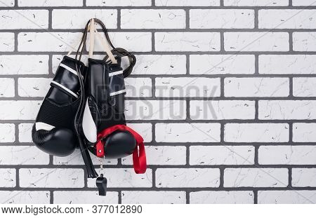 On The Brick Wall There Is A Hook On Which Wrestling Gloves And Jumpers Hang, There Is A Place For I