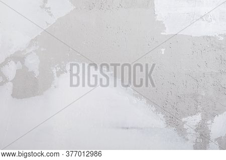 Background Of A Concrete Wall With Partially Applied White Plaster