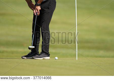 Playing Golf Preparing To Shot, Man Putting On Green