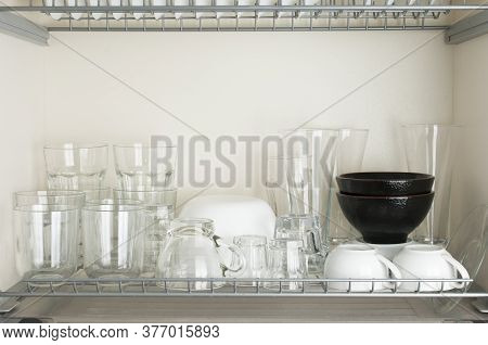 Typical Italian Dinnerware Cabinet With Glasses And Bowls For Different Beverages And Foods