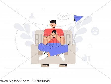 The Concept Of Social Networks And Online Communication In Home. Young Man Is Sitting In Chair And C