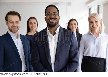Portrait Of Diverse Staff Lead By African Leader Photoshooting Indoor