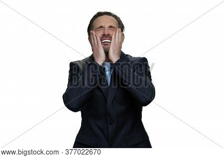 Wailing Office Employee In Suit. Middle-aged Manager Is Crying. Mature Crying Man Isolated On White