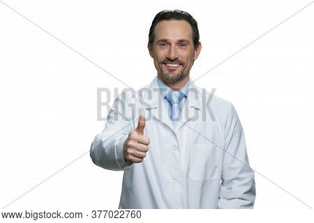 Friendly Male Doctor Dressed In A White Robe. Smiling Physician Isolated On White Background.