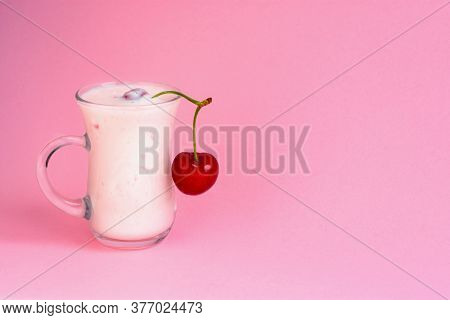Cherry Yogurt In A Mug On A Pink Background. A Delicious Milk Drink With Bits Of Cherries. Bright Pi