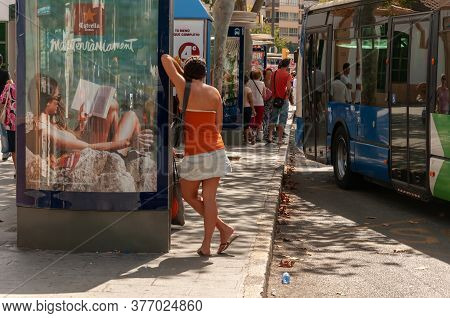 Palma De Mallorca, Balearic Islands/spain; September 2014: A Girl On Her Back Waiting For The Bus, L