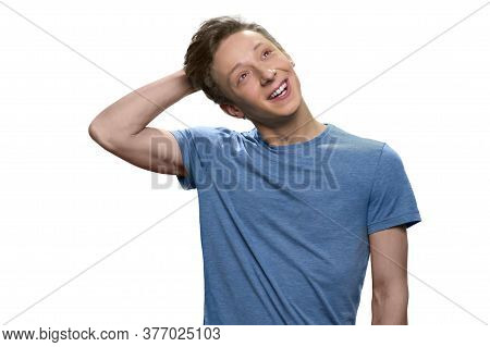 Skinny Teen Guy Is Daydreaming Touching His Head. Isolated On White Background.