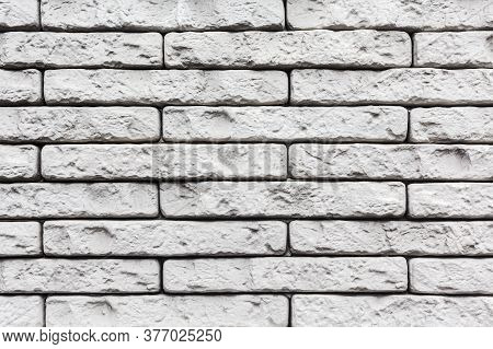 White Stone Wall Texture. Abstract Pale Masonry Background