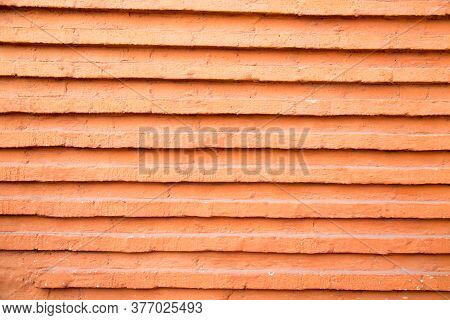 Brickwork Of Red Brick With Projecting Horizontal Rows. Architecture Design Details Construction.