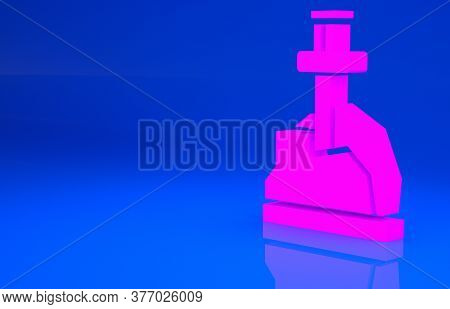 Pink Sword In The Stone Icon Isolated On Blue Background. Excalibur The Sword In The Stone From The