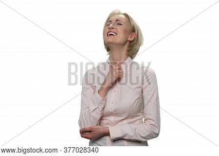Portarit Of Beautiful Businesslady Is Laughing Heartily. Mature Middle Aged Blond Woman Is Laughing
