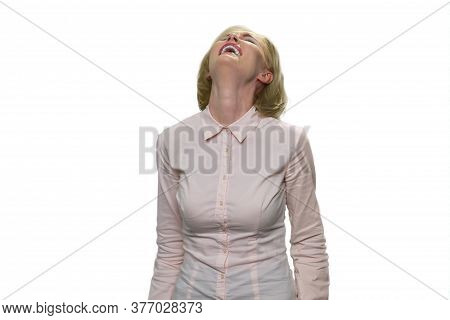 Close Up Portrait Of A Beautiful Middle Aged Woman Laughing Against White Background. Mature Lady We
