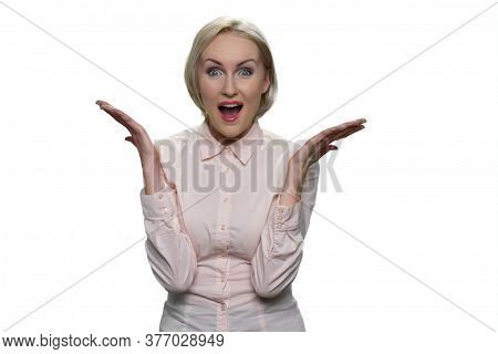 Beautiful Lady With Her Blonde Hair With Open Palm Hands And Open Mouth Isolated On White Background