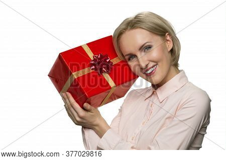 Portrait Of Smiling Joyful Woman With Celebratory Gift Box. Giftbox With Gold Ribbon.