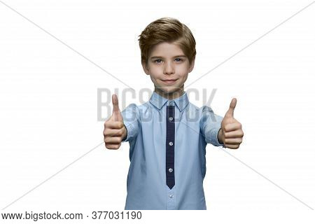 Boy In Blue Shirt Showing Okay With Both Hands On White Background. Smiling Kid Male With Outstretch