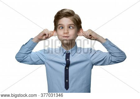 Boy Makes A Face On White Background. He Pulling Back His Ears Like A Monkey.