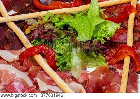 Trio Of Dried Delicacies. Basturma, Prosciutto, Sausage Flat. Plate With Delicacies. Close Up