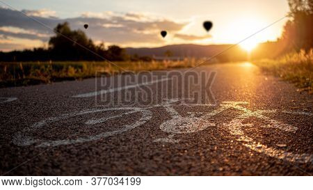 Close Up Of Bike Traffic Sign On Concrete Sunset Cyclo Way With Warm Dusk Atmosphere