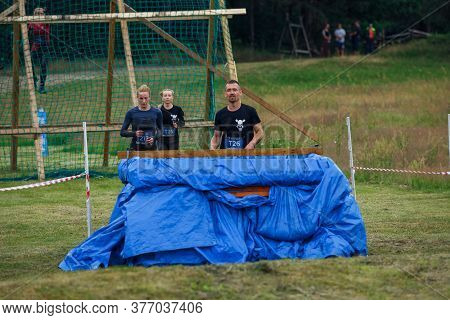 City Riga, Latvia. Run Race, People Were Engaged In Sports Activities. Overcoming Various Obstacles