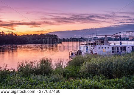 Belgrade / Serbia - June 18, 2020: Old Dilapidated River Raft On The Bank Of Danube River With Color