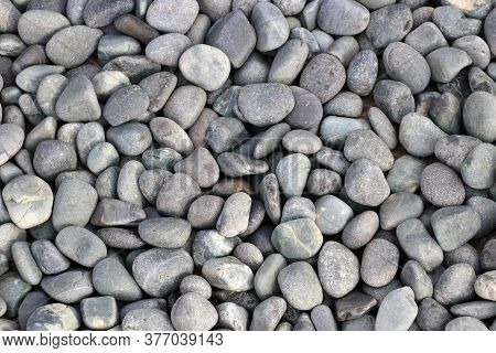 Pattern Of Round Pebble Stone. Background Of The River Rock Pebbles.