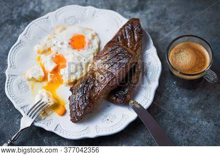 Close Up Of Rustic American Australian Steak And Eggs Breakfast