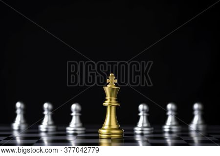 Golden King Chess In Front Of Silver Pawn Chess On Chess Board And Black Background. Leadership And