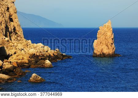 A Rock Resembling A Sail In The Blue Sea At Sunset On Coast Of The Crimea