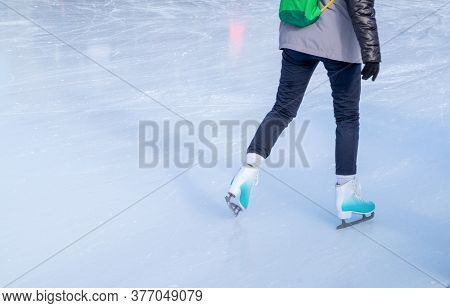 A Young Girl Skating In Winter Clothes For Outdoor Activities At The Rink In Winter. Healthy Lifesty