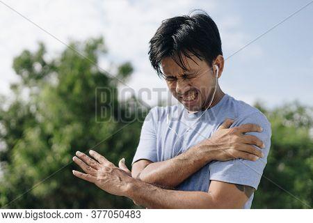 Sport Asian Man Have Shoulder Pain, Sport Injury Concept