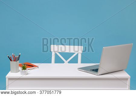 Office Light Interior Of Workplace, White Table Desk With Modern Laptop Pc Computer, Orange Notebook