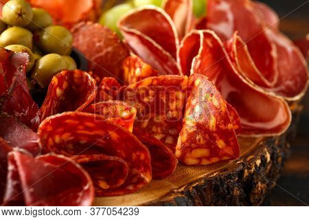 Dry Cured Fermented Beef And Pork Meat Cocktail Selection With Salami, Chorizo, Cheese, Olives And G