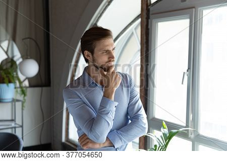 Thoughtful Caucasian Man Look In Distance Pondering Or Thinking