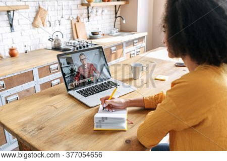 Webinars, Online Learning, Online Classes. A Female Student Using Laptop For Watching Lectures Onlin