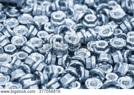 Close-up Scene Pile Of Special Nuts For  Construction  Industry.the Anti-loose Nut For Industrial Pu