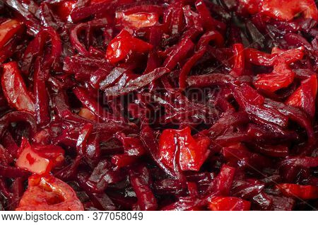 Red Beet Stew With Tomatoes Background. Sliced Beets, Ripe Tomatoes And Olive Oil. Close-up. Selecti
