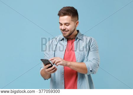 Smiling Young Bearded Guy 20s In Casual Shirt Posing Isolated On Pastel Blue Wall Background Studio