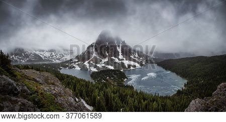 Beautiful Panoramic View Of The Iconic Canadian Rocky Mountain Landscape During A Dark And Moody Sun