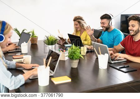 Young Friends Working Together Inside Co-working Creative Space - Millennial People Doing Startup St