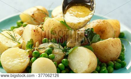 Warm Vegetarian New Baby Potato Salad With Petit Pois Peas, Dijon Mustard And Capers Dressing, Serve