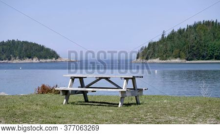 Lonely Park Picnic Table Overlooking The Ocean In Quebec, Canada Parc Du Bic.