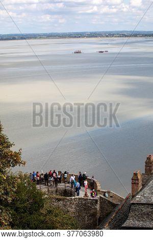 Le Mont-saint-michel, France - September 13, 2018: Crowd Of Tourists At Mont Saint-michel, The Monas