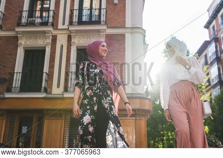 Muslim Girls Spending Time Together Outdoors. Two Muslim Girls Wearing Hiyad. Friendship Concept.